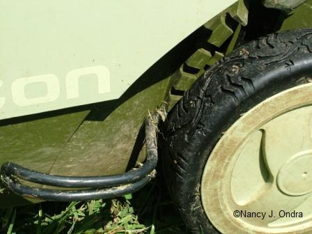 Neuton mower height adjustment lever