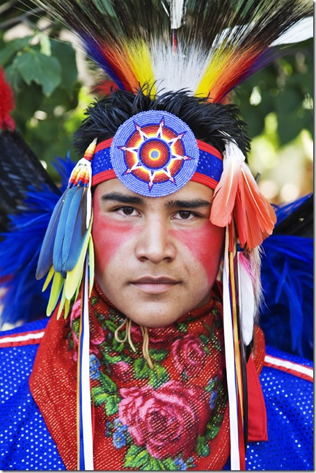 Elliot Tsoodle, a Navajo-Kiowa from Albuquerque, prepares to participate in the Native AMerican Costume Contest at the 2009 Santa Fe Indian Market.