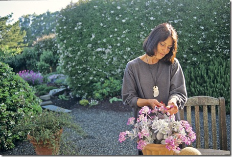 Gardener and designer Sarah Hammond works in the early morning in her garden retreat in Bolinas
