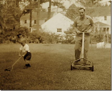 Me and my Pop mowing the lawn circa 1955