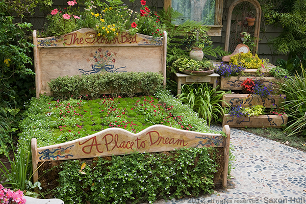 """A Place to Dream"" - a bit of garden whimsy causes us to question our assumptions on just what a garden bed can be."