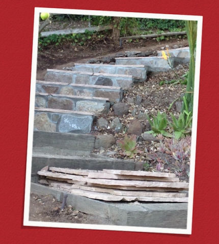 Steps leading to the garden are being paved with flagstone.